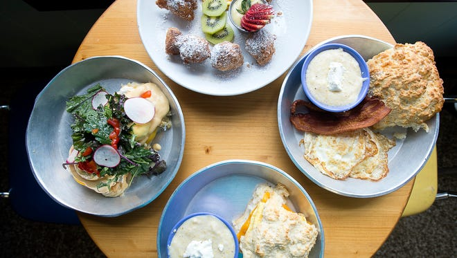 [From top] Biscuit donuts, a full breakfast- with two medium eggs, grits, bacon, and a biscuit, a biscuit sandwich with a side of grits, and the Asheville Benedict.