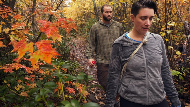 Chloe Hawkins, right, and Nathan Foley, both from Charlottesville, hike along Riprap trail in the Shenandoah National Park on Oct. 12, 2014.