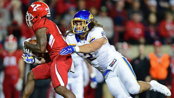 South Dakota State linebacker Christian Rozeboom(2) tackles Youngstown State wide receiver Alvin Bailey(5) during the first half of their game Saturday, Sept. 30, 2017, at Stambuagh Stadium in Youngstown, Ohio. (David Dermer | The Vindicator)