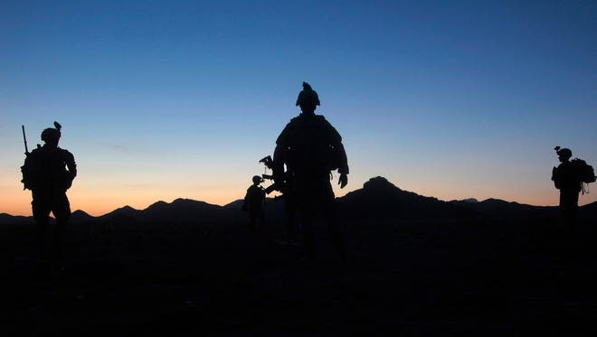 U.S. Army soldiers set out on a night mission in Afghanistan's Kandahar province.