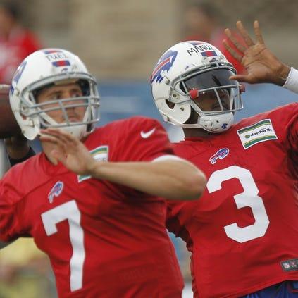 Bills quarterbacks EJ Manuel, right, and Jeff Tuel drop back.