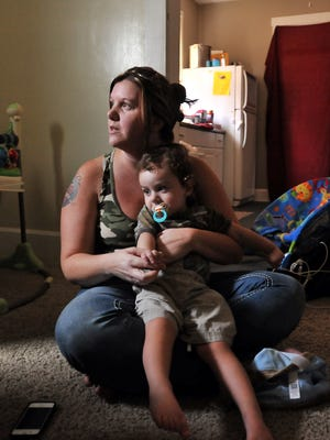 Jessica McNichols holds her youngest son Tucker Harper Thursday, Sept. 3, 2014, at their home in Lancaster. Tucker was diagnosed with Lesch-Nyhan Syndrome, a genetic disorder, in March.