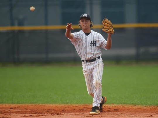 Maclay second baseman Davidson Oberste throws to first base for an out.