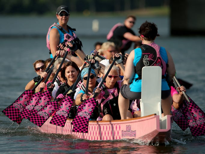 First Lady Karen Pence, center, paddles with members of Indy SurviveOars on Geist Reservoir, on Wednesday, July 30, 2014, in Indianapolis. The Indy SurviveOars Dragon Boat Racing team is comprised of breast cancer survivors from the Geist area.