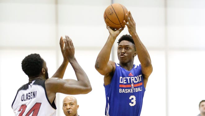 The Detroit Pistons' Stanley Johnson shoots over the Miami Heat's Gabriel Olasseri during a summer league game July 10, 2015, in Orlando.