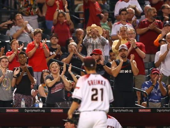 Diamondbacks fans cheer as pitcher Zack Greinke leaves