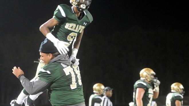 St. Bonaventure receiver JR Waters celebrates a touchdown against Centennial during Saturday's season opener at Ventura College.