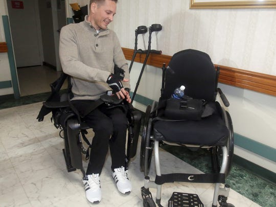 Rusty Chmelovsky, 39, a patient at Burke Rehabilitation Hospital in White Plains, takes a rest after walking with the ReWalk robotic exoskeleton device Dec. 20, 2017. Chmelovsky was left paralyzed from the waist down after a construction accident in 2008. The ReWalk device provides powered hip and knee motion to enable the him to stand upright, walk and turn. With him is physical therapist Glenda Rosado.