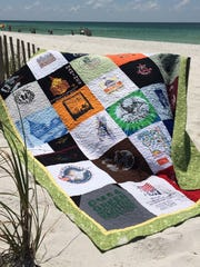 Cheryl Murdock operates Run With It Quilts out of her home in Pensacola North Hill, where she turns people's old T-shirts into memorable quilts.