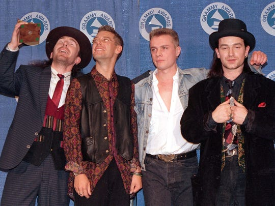 The Irish rock group U2 wins a Grammy for album of the year, The Joshua Tree, at the Grammy Awards ceremony at New York's Radio City Music Hall on March 2, 1988.  The band members, from left, are, The Edge, Adam Clayton, Larry Mullen and Bono.