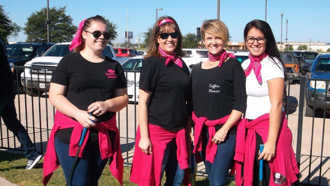 Team Pink Ladies, from Family Vision Associates, competes in the ninth annual Putt Fore Children Miniature Golf Tournament benefiting Day Nursery of Abilene.