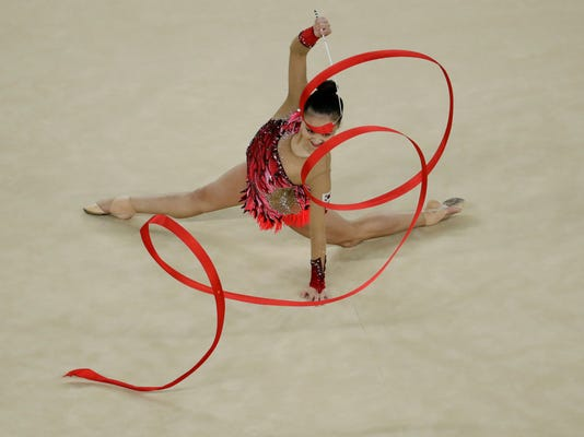 South Korea's Son Yeon-jae performs during the rhythmic gymnastics individual all-around final at the 2016 Summer Olympics in Rio de Janeiro, Brazil, Saturday, Aug. 20, 2016. (AP Photo/Dmitri Lovetsky)