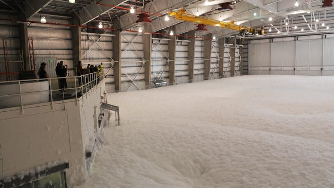 The 83,000 square foot AeroMod International hangar at Orlando Melbourne International Airport uses a newer, more environmentally friendly fire suppression foam than past products, which contained toxic fluorinated compounds.