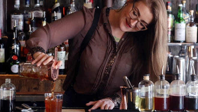 """Kala Ellis, bartender at Gray's on Main, prepares her """"Catcher in the Rye"""" drink which is the cocktail for this year's Heritage Ball Thursday September 7, 2017."""