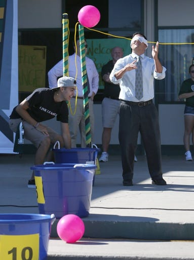 JOE LUMAYA/SPECIAL TO THE STAR Royal High School's Assistant Principal Mathew Guzzo competes in a game during a rally to welcome students back to school Wednesday in Simi Valley.