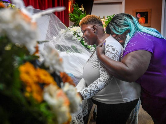 Debrianah Begley's grandmother Aretha Perkins Begley and mother Tika Begley comfort each other as they view her at the Revelation Funeral Home in Nashville, Tenn., Thursday, October 12, 2017.