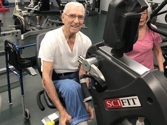 Wilbur Donley on a recumbent bike he donated to Kids America part of recent gym renovations.