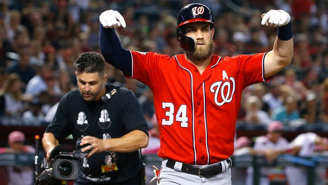 Nationals Bryce Harper (34) gestures at home celebrating after hitting a home run against the Diamondbacks during the third inning at Chase Field in Phoenix, Ariz. on May 13, 2018.