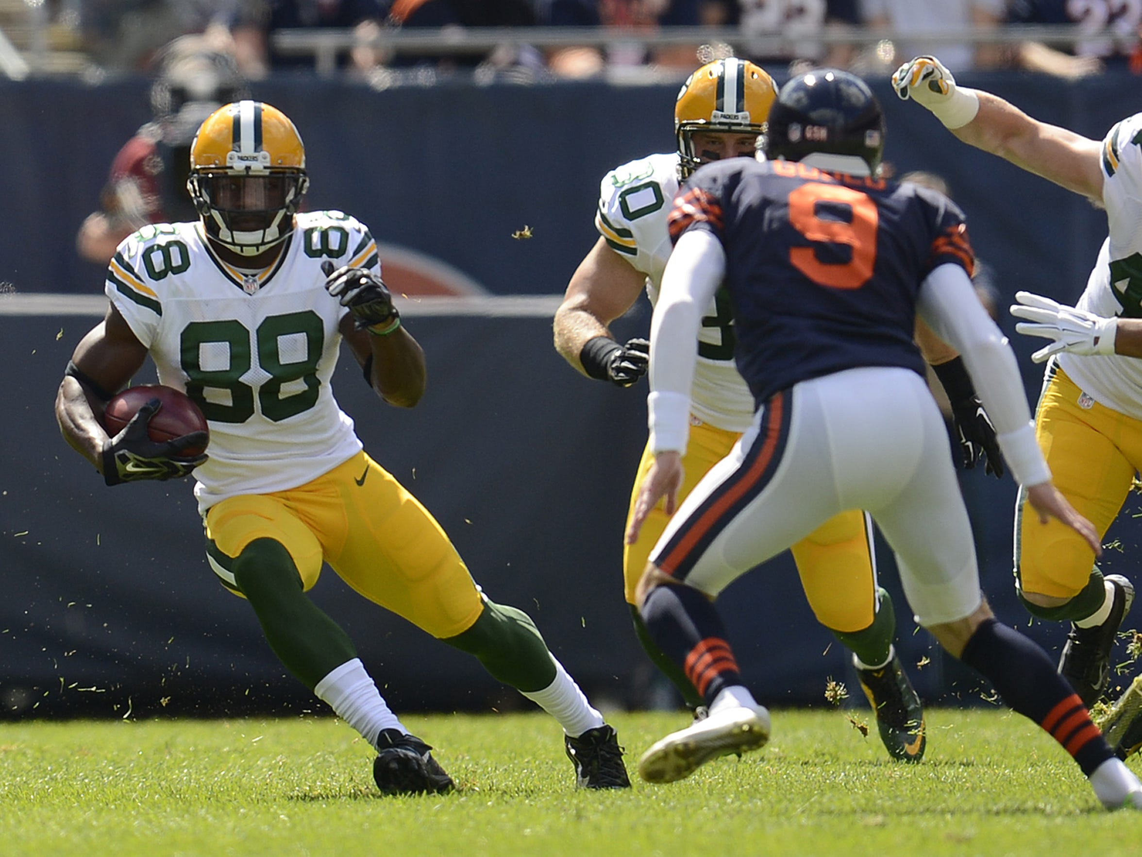Green Bay Packers return man Ty Montgomery (88) runs with the ball during a kickoff return during Sunday's game against the Chicago Bears at Soldier Field in Chicago.