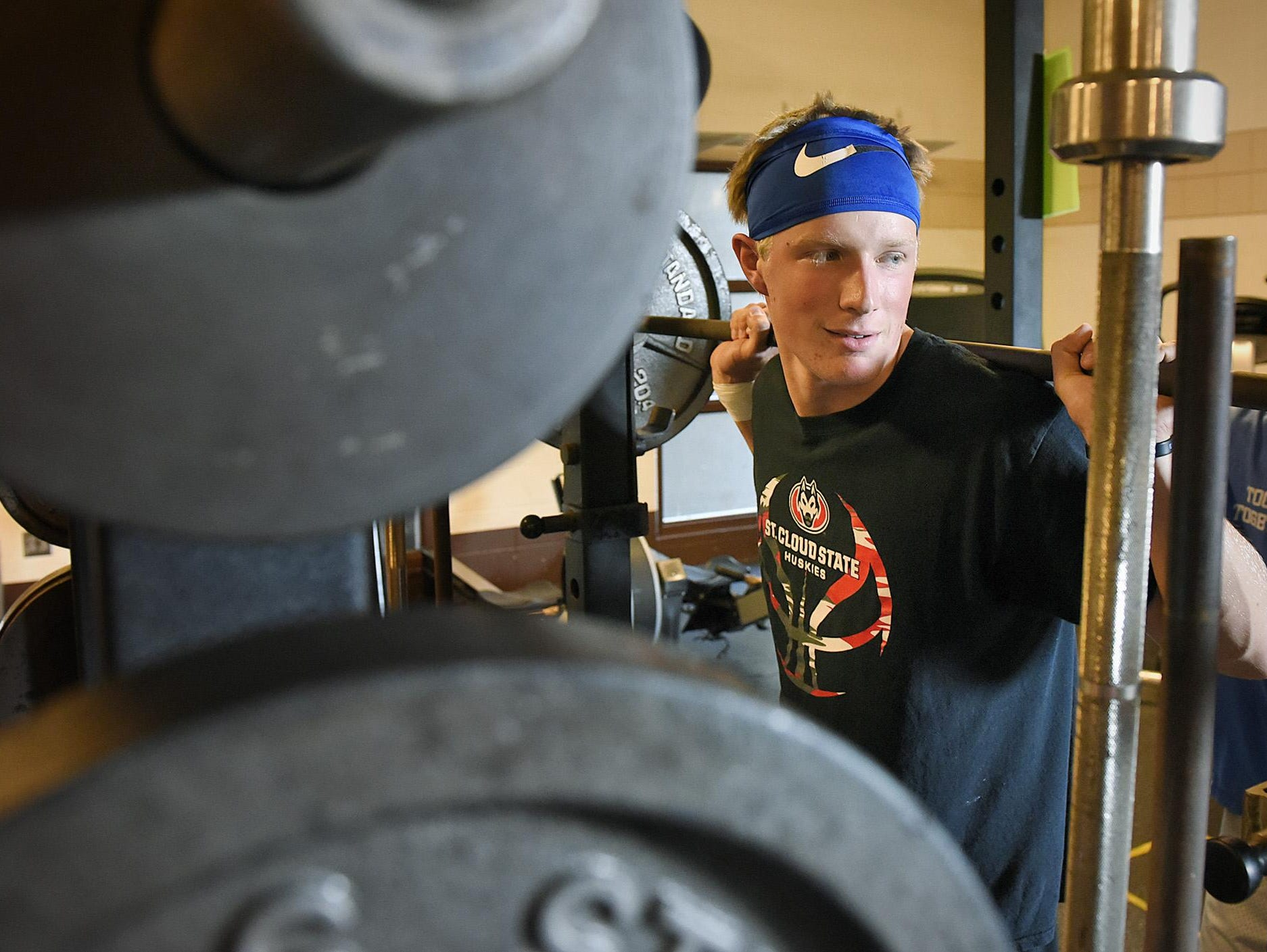 Foley quarterback Kyle Kipka lifts weights before practice Monday in Foley.