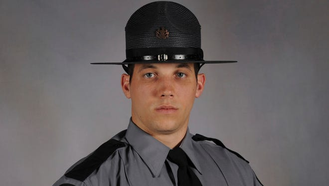 Trooper Michael P. Stewart was killed and another trooper injured early Friday, July 14, 2017, when their patrol car collided with a garbage truck in Ligonier Township, Pa., southeast of Pittsburgh.