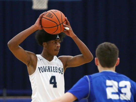 Poughkeepsie's Niyal Goins looks to make a pass against