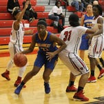 Northwest sophomore forward Fatimah Shabazz spins and drives to the basket.