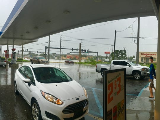Scenes from the 7-Eleven at Midway Road and U.S.1 in St. Lucie County Sunday, Sept. 10. The store was one of the few still open as Hurricane Irma approached.