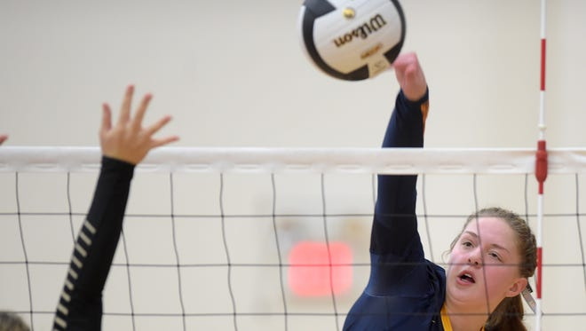 Seton Catholic's Sarah Dickman hits the ball against Daleville during the volleyball regional Tuesday, Oct. 25, 2016 at Seton Catholic High School in Richmond.