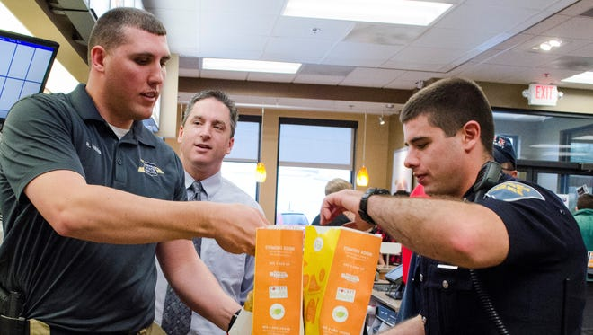 Local safety officials helped drop off orders to customers at Chick-Fil-A, 511 W. McGalliard Road, on Saturday during the Battle of the Badges event at the restaurant.