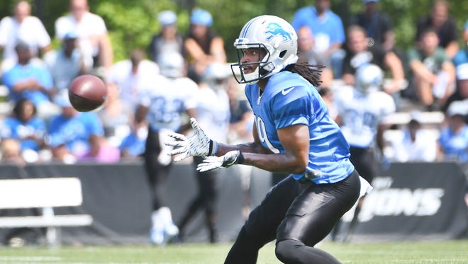 Wide receiver Andre Roberts readies for a reception during drills.