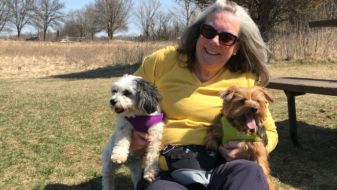 Linda Niedziejko, a retired nurse from Summit, poses with her dogs, Tilly (left), a Havanese, and Margie, a Yorkshire terrier, recently at Nashotah Park.