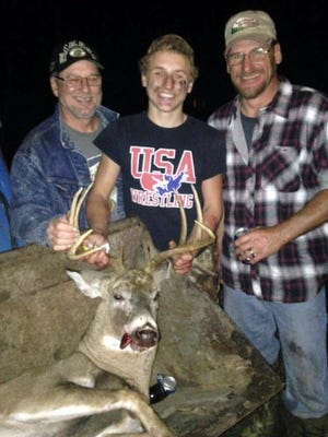 Noah Meissner, 17, of Manitowoc, center, shows the nine-point buck he arrowed near Reedsville. Helping him with the tracking was his dad, Todd Voeltz, right, and his grandpa, Bruce Meissner, left. This is Noah's third large buck in five years with his bow.