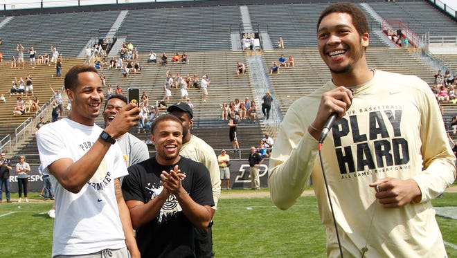With teammates looking on, A.J. Hammons announces during halftime of the spring football game that he will return for his senior season.