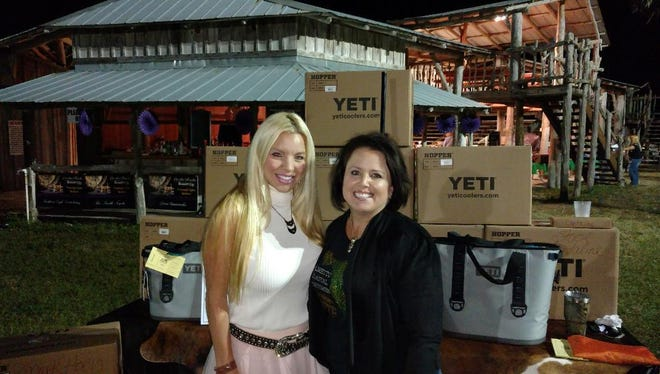 Meghan Gonzalez, left, of Bev Smith Automotive Group, left, and Denise Helms, with the Palmetto Coastal Sportsmen Chapter of the National Wild Turkey Federation at the 2016 Roundup at the Ranch banquet.