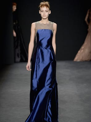 Olympic fever is spreading, but the fashion frenzy continued at New York Fashion Week.<br /> <br /> Here, a model strides down the runway in a blue gown from Carmen Marc Valvo. <br /> <br /> Click ahead to see shots from other Friday shows.