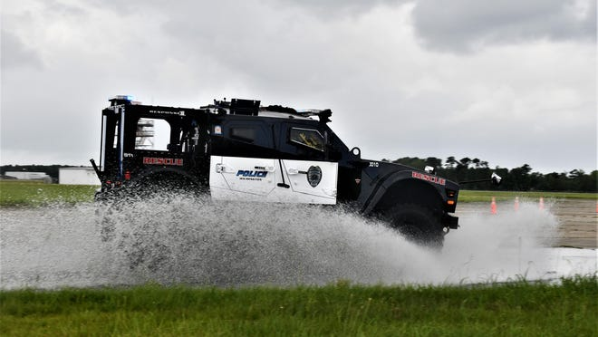 Wilmington Police Department's M-ATV (Military All-terrain Vehicle) seamlessly passing through a flooded area without losing traction and hydroplaning.