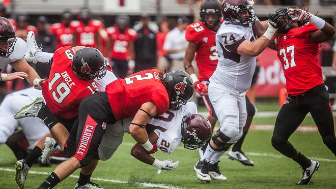 A linebacking crew in motion: Ball State's Zach Ryan (2), Ben Ingle (19) and Aaron Taylor at work Saturday afternoon against Colgate.
