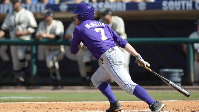 LSU Tigers outfielder Sean McMullen (7) follows his hit against the Vanderbilt Commodores during the championship game of the SEC baseball tournament at the Hoover Met.
