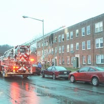 Firefighters respond to a fire at an apartment in the 100 block of 19th St NE