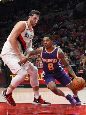Phoenix Suns guard Tyler Ulis tries to drive past Portland Trail Blazers center Jusuf Nurkic during the second half of an NBA basketball preseason game in Portland, Ore., Tuesday, Oct. 3, 2017. The Suns won 114-112.