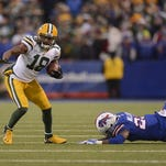 Green Bay Packers receiver Randall Cobb (18) shakes off Buffalo Bills safety Aaron Williams (23) after making a catch in the fourth quarter during Sunday's game at Ralph Wilson Stadium in Orchard Park, N.Y.