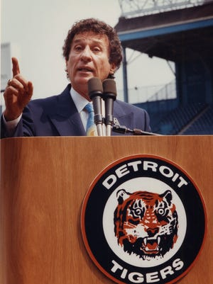 Mike Ilitch at the podium at Tiger Stadium after purchasing the team in 1992.