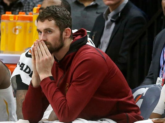 FILE - In this Jan. 8, 2018, file photo, Cleveland Cavaliers' Kevin Love watches from the bench in the second half of an NBA basketball game against the Minnesota Timberwolves in Minneapolis. Love will miss two months with a broken left hand, but he does not need surgery. Love broke the fifth metacarpal Tuesday, Jan. 30, in the first quarter of a loss at Detroit. (AP Photo/Jim Mone, File)