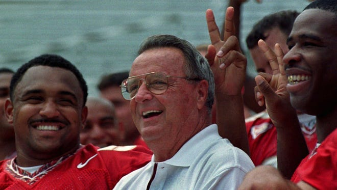 Bobby Bowden jokes with his linemen in this 1998 file photo.
