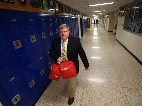 Roxbury High School Principal Jeff Swanson walks down the hall after he was given two Griffin Logistics Tramedic trauma kits, presented by Roxbury Police and Rotary Club to the high school. Roxbury is the first municipality in the country to outfit every school with a trauma kit. March 18, 2016. Roxbury, N.J.