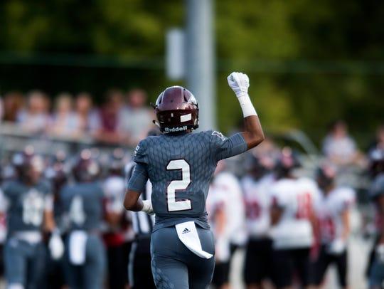 Fulton's Coryean Davis (2) celebrates on the field