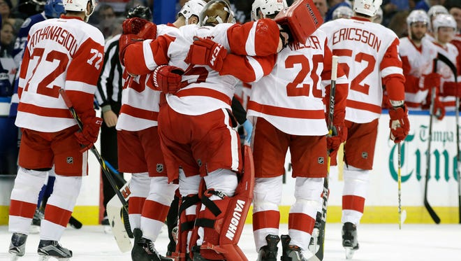 Detroit Red Wings goalie Jimmy Howard (35) is helped off the ice by his teammates after getting injured during the second period.