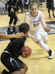 ACU's Sydney Shelstead, right, lunges for the ball after a Stephen F. Austin player came up with a loose ball. SFA won the Southland Conference game 70-61 on Thursday, Jan. 12, 2017 at Moody Coliseum.