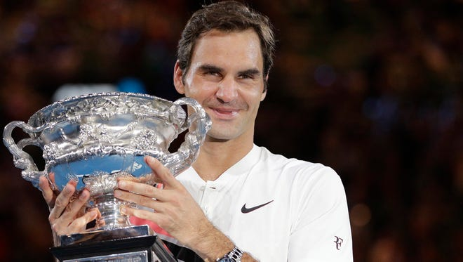 Roger Federer holds the trophy after winning the Australian Open on Sunday.
